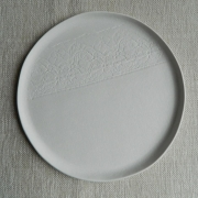 Plate with lace ornament